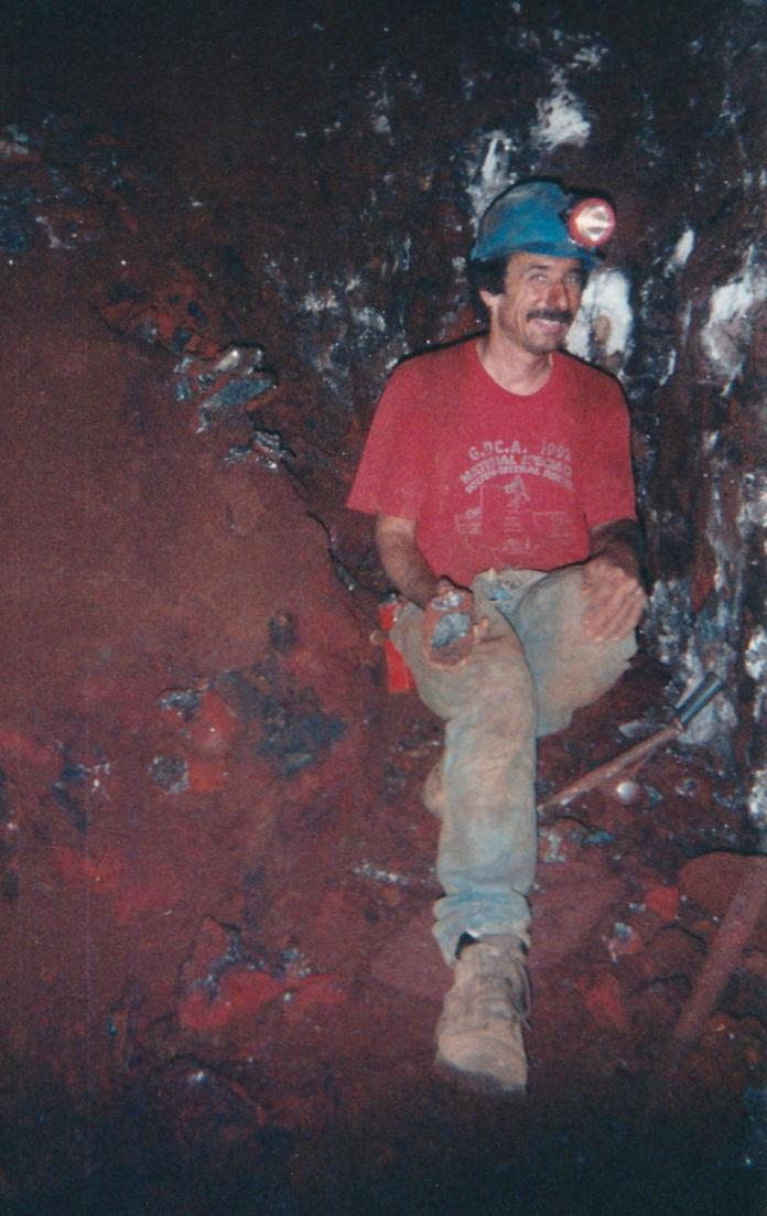 Stan Esbenshade digging in the hemimorphite area in the Ojuela mine. 1998